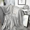 jilda-tex Wohndecke Lines Light Grey auf einem Stuhl
